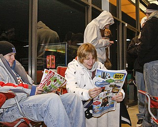 L-R Bryan Piccirillo (22) and Robert Colick (22) of New Castle camp out in line at Best Buy in Boardman, Thursday November 27, 2008