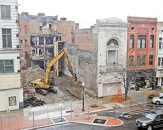 ON SCHEDULE: Demolition of the former State Theatre building continues in downtown Youngstown, making way for a center for high-tech ventures. The State Theatre was built in the fall of 1927 and was the fourth picture house to be at that location on West Feeral Street. It later served as the Agora rock nightclub.