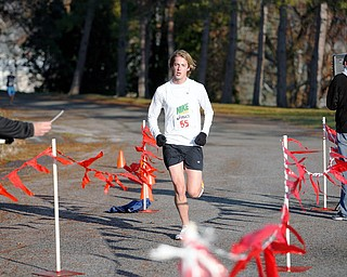 FINISH LINE: Scott Wolfe of East Palestine runs to victory at the first East Palestine Turkey Trot on Thanksgiving Day. Organizers hope to make the run an annual event.