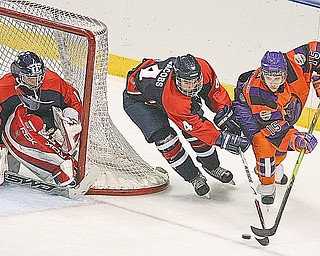PHANTOMS - TRAVERSE CITY - (15) Jordy Trottier of the Phantoms battles (4) Bo Jacobs as (1) Brandon Stephenson keeps his eye on the puck during their game Friday night at the Chevrolet Centre.