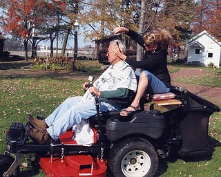 When Dan Burkey was too busy for a haircut, his stylist, Linda Moyer, decided to come to him. He was cutting grass at the Canfield Fairgrounds Western Reserve Village. Photo sent by Diane Playforth, a Western Reserve Village trustee.
