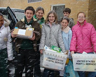 Students from St. Patrick school in Hubbard load food that the school collected for the St. Vincent De Paul Society.  