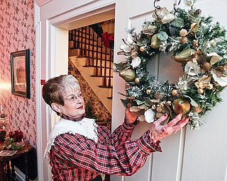 Colette Chuey, Vice Pres. of Girard Historical Society makes  prepartions for  Christmas at the Barnhisel House event.