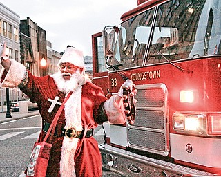 Santa is brought in by Youngstown Fire Department  during the Christmas Tree lighting in downtown Youngstown, Friday December 5, 2008