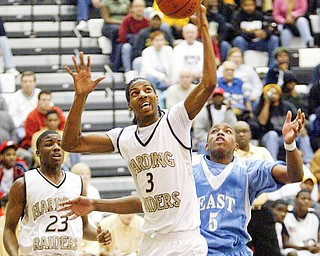 Harding's Desmar Jackson pulls down a rebound past Mark Thornton of East.