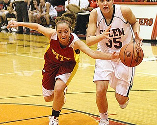 OUT OF REACH: Mooney's Jessica Farragher (11) knocks the ball away from Salem's Amy Scullion (35) during their game Monday night in Salem. The Quakers defeated the Cardinals, 53-38.