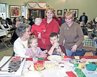 FAMILY SUPPORT: The Nosek family of Berlin Center attends the holiday party for The RIch Center at Weather Tite Windows in Liberty. The family thanks the center for helping 7-year-old Caden Nosek, who has an autism spectrum disorder, learn to better communicate. Standing are mother Kimberly Nosek, holding her daughter Avrie, and relative Gale Saunders. Sitting in front of them are Becky Burnett, holding her granddaughters Zoey, and Caden.