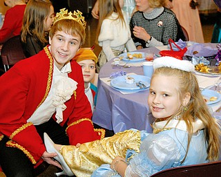 "Claire Toth, 7 1/2 of Pulaski, PA tries on the glass slipper with a little help from The Prince ""Matt Stevens"" during the Cinderella brunch held at the Trinity United Methodist Church in Youngstown on Saturday."