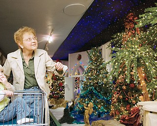 "Mary Ellen Boomhower pushes her grandaughter, Hannah Zagotti (age 1) through Kranyak's Christmas display in Hermitage. ""I brought my kids here when they were little,"" says Boomhower, ""Its a real treat to bring the little-er ones."" ""This is my gift to see all this,"" says Boomhower who was blind for eleven years before a surgery 19 years ago brought her eyesight back, ""it surely is."" Diabetes once robbed the grandmother of her sight and the illness continues to threaten her as she waits for a kidney transplant."