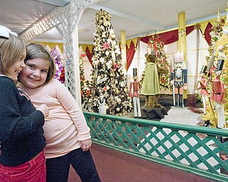 "Meredith Lauther gets a hug from her cousin, Lexi Tonty, both 4 year old residents of Sharpsville, while viewing the displays at Kraynaks in Hermitage, PA. ""This is where we come after pre-school,"" says Lauther's grandma, Linda Hazi, ""we've been here at least ten times this year."""