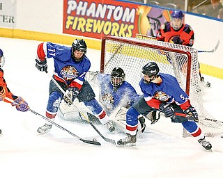 Phantoms Cole Schneider (24) gets blocked from making a goal by Andy Yarber (77), Goalie Nick Graves (30) and Ryan Sell (5) Sunday December 28, 2008