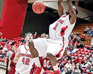 TWO WITH AUTHORITY: De'andre Mays (1) of Youngstown State slams home a basket in the first half of Monday's game against Lock Haven at Beeghly Center. Mays scored 13 points and had six rebounds int eh Penguins' 81-60 win.