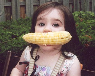 Phyllis Olson of Poland captured this shot of her little friend, Coco Aurini, 2, of Michigan, who was enjoying her first corn on the cob.