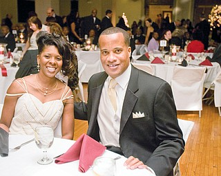 Mayor Jay Williams sits down with his wife, Sonja , during the Mayor's Community Celebration at Stambaugh Auditorium.