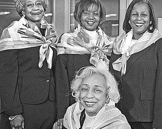 <p>SOMETHING TO SMILE ABOUT: Organizers of the annual Snowflake Ball presented by Epsilon Mu Omega Chapter of Alpha Kappa Alpha Sorority are, seated, Mary Lois Gross, program director and a 50-year member of the chapter, and standing, from left to right, Carole Prestley, decorations; Beverly Fortune, co-chair; and Sandra Smith Graves, co-chair.</p>