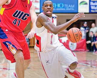 YSU's #1, DeAndre Mays drives down the court past UIC's #41, Scott VanderMeer, during a matchup at YSU's Beeghley Center Thursday night.