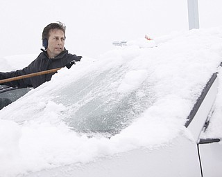 Sales and Leasing Executive Rodney Stanko of Niles cleans off cars in the lot at Greenwood Chevrolet in Austintown, Saturday January 10, 2009