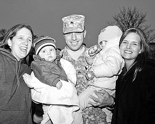 Maria Zinner, Kaden (8 mths) Brandon (23) Madison (2) and Candice (22) Zinner. Staff Sgt. Rudy Santibanez Sr of Toledo returns home from his 3rd tour in Iraq, Saturday January 10, 2009