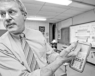 Fitch math teacher Tom Reardon demonstrates use of nspire, a device used in his math class.