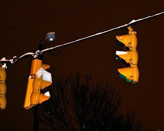 Ice and snow accumulate on a traffic light in Youngstown