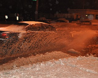 A car makes its way through high water on Mahoning Avenue in Youngstown.