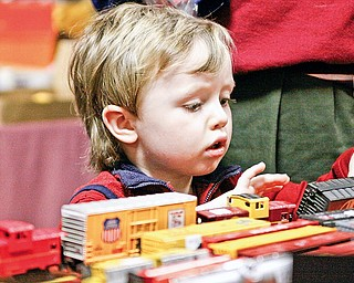 Hadley Reese (3) of Youngstown plays with model trains at McMenamy's Banquet Hall in Niles for the 2009 Winter Flea Market hosted by Youngstown Model Railroad Association
