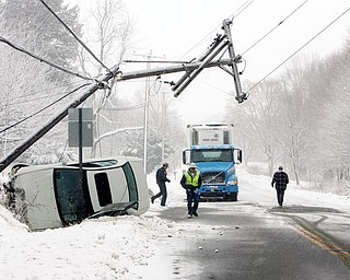 Snow and slippery roads caused a  single car wreck on St Rt 62 - just south of 165 closed St Rt 62 for some time as the car snapped a pole and brought down electrical wires - unknown how many people were in the car but an ambulance did leave the scene as I arrived - Perry Twp. Police Dept handled the crash