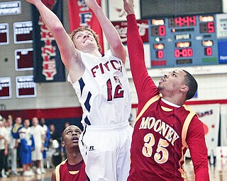 Shane Stevens of Fitch shoots past Chuck Gruber of Mooney during Tuesday action at Fitch.