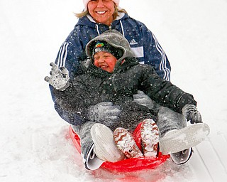 Hayden, 3 1/2, and mom, Amanda Taylor of Hubbard, didn't let a little snow and cold stop their fun as they played on the hills in Wick Recreation area in Mill Creek Park