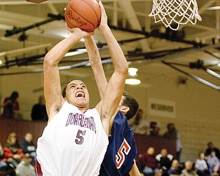 Boardman's Chase Hammond attempted block by Fitch's John Williams