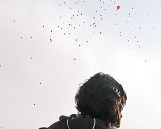 Luiz Velazquez watches as balloons he and others from Williamson Elementary released in celebration of their hopes and dreams on Barack Obama's Inguration Day, Tuesday January 20, 2009