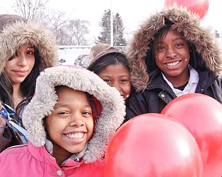 Williamson Elementary students Yamely Aponte (11), Shakaiylah Jefferson (11) Tonneiqua Shade (11) and Shakuilla Moore (12) hold balloons of hope that are to be released on Barack Obama's Inguration Day, Tuesday January 20, 2009