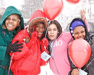 Ms. Lane, Tyler Johnson, Kassandra Roman and Alexis Taylor stand outside Williamson Elementary in Youngstown to release balloons with paper attachments of their hopes and dreams, Tuesday January 20, 2009