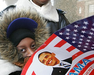 Rashaan Nelson , 8,and his mother Beatrice Nelson during inaugural festivities Tuesday