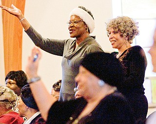 IN THE SPIRIT: Carolyn Johnson, left, and Carolyn Williams, both of Youngstown and members of Union Baptist Church in Youngstown, stand and sing with the choir during a community worship service at Price Memorial Episcopal Church, Youngstown.