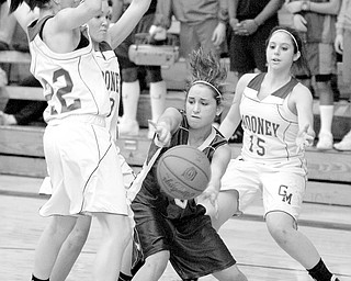 Ursuline's Lucia Petrus (3) struggles to pass the ball while being triple teamed by Mooney's Dominique Zordich (22), Katie Hughes (13), and Angela Stana (15) during the second quarter at Cardinal Mooney High School in Youngstown.