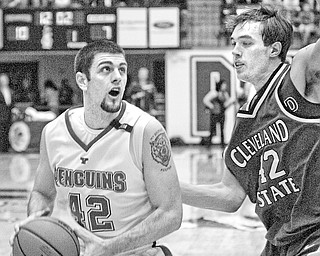 Dallas Blocker of YSU tries to shoot past Chris Moore of CSU.