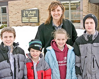 L-R Brendan (10) Patrick (6) Molly Faloon, Kathleen (7) and Colin (9) Faloon. Molly picked up her children from St. Joseph School in Austintown, Friday January 23, 2009