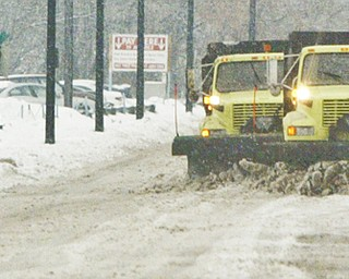 City plows run in tandem along Front St in Youngstown Wed. morning. wdlewis