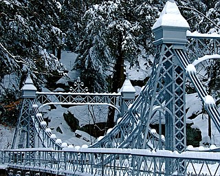 "Mill Creek Park's ""Cinderella bridge"" offers an entrance to Dan Shields' winter wonderland."