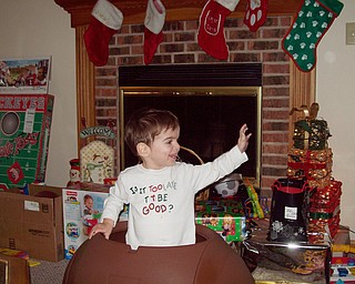 Nathaniel Richley pops out of the toy chest he received for Christmas from his grandparents, Paulette & George DiLullo.