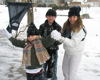 Christopher, Sam and Amber Clingan of Boca Raton, Fla., had fun with their first snowfall while visiting uncle and aunt, Paul and Barb Fitzpatrick of New Middetown.