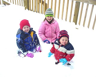 Jessica Crouse and snaps daughter Hannah and sons JD and Heath playing in the snow.