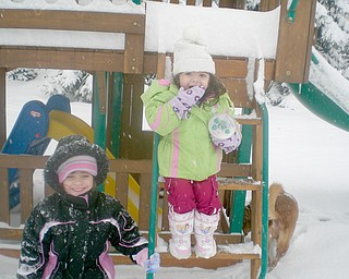 4-year-old Breanna and 2-year-old Alivia Maderitz managed to enjoy their playgym even in the snow!