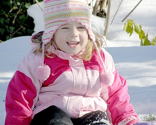 McKenna Sweeney, 3, loves wearing her snowsuit for a wintry romp in her backyard.