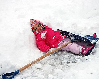 Allison Jones, 3 1/2, takes a break from shoveling with her mom, Sally Jones of Canfield during the Jan. 10 snow storm.