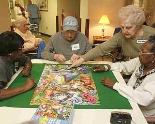 THE VICTORY TEAM - Sandy Green  Mike Kadilak  Eleanor Timko (residents Wife)  --- Ruth Brown as they put the final touches on their puzzle -as Beeghly Oaks celebrates its 20th anniversary --  robertkyosay