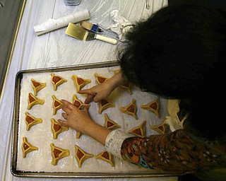 Putting on a crust is Sherri Clayman  as the church makes Hamentaschen cookies for Purim- robertkyosay