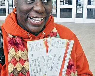 Nia Simms of Youngstown shows off tickets she purchased Wednesday at the Chevy Centre for upcoming Pavlik fight.