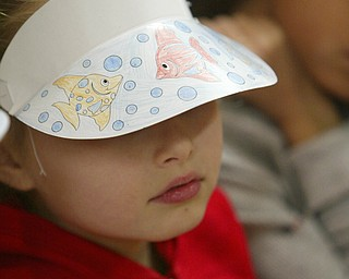 Madison Perez painted a sunvisor  as Right to Read week activities got underway at Robinhood Elementary in Boardman -